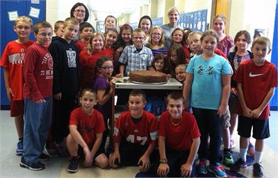 Students around the 'Bruce Bogtrotter' giant cake