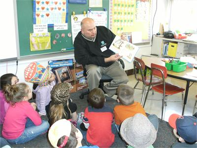 Board of Education Member Mr. Greg Surtman reads to Mrs. Burk's Class