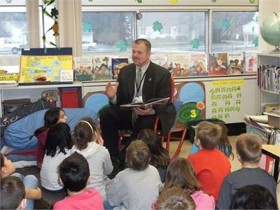OFIS Principal Mr. Don Svec reads to Mrs. Reitz's class
