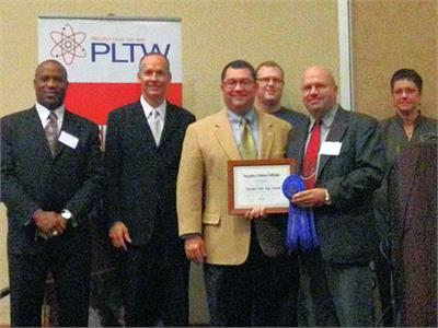 Teacher Michael Haydn receiving PLTW certification.